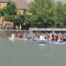 FIERCE CHALLENGE: The Taniwhas paddling to victory on the Thames.